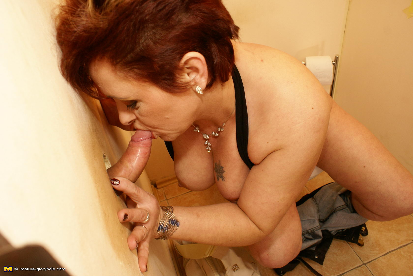This nasty mature cockslut does two spears at once